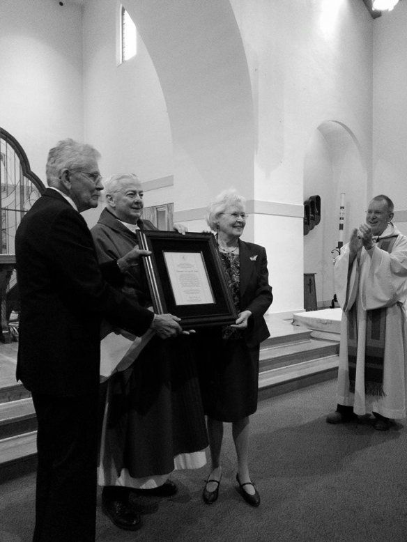 Rev. Richard Warner, CSC, Superior General, presents the Spirit of Holy Cross Award to Ed and Lea Zorn